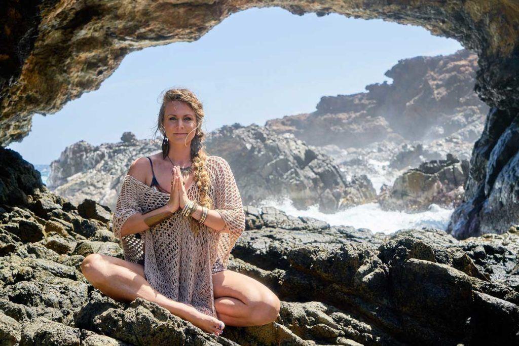 Yoga Girl meditating near the water