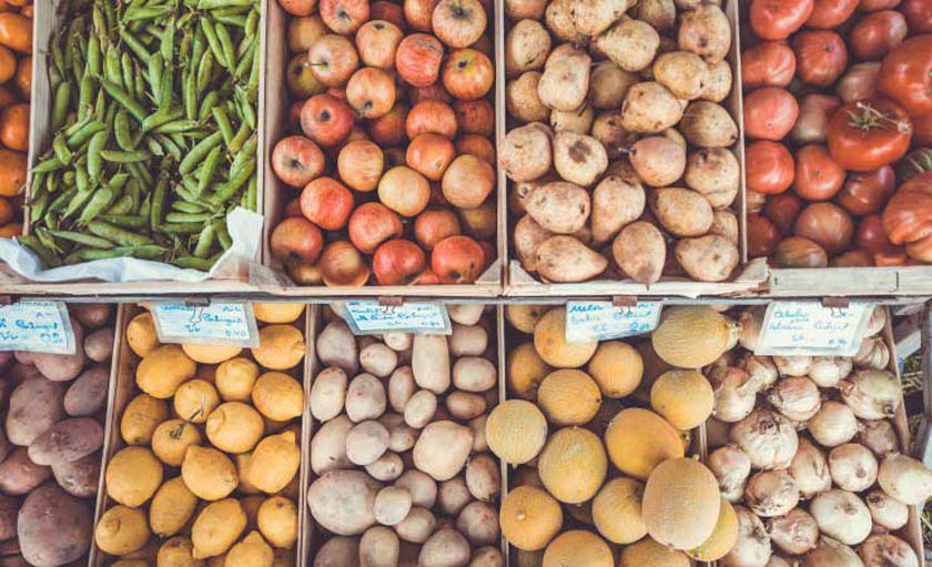 different fruits and vegetables on display in a farmer's market