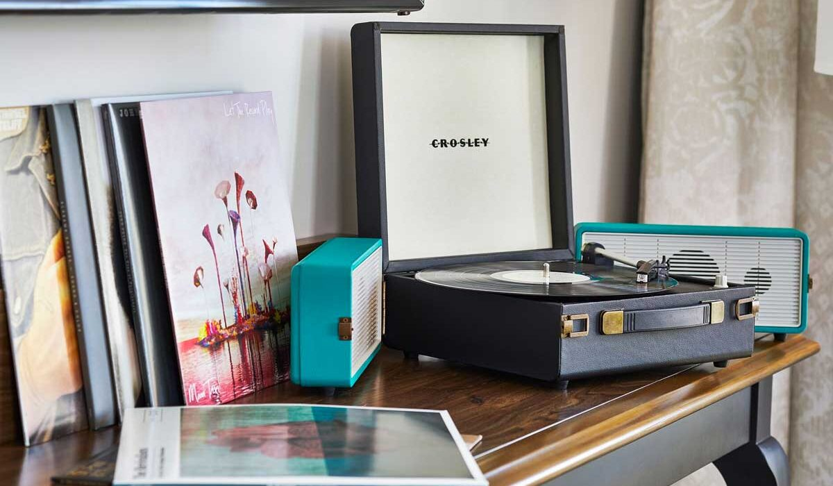 record player and records on a brown table