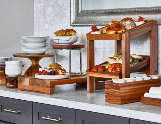 wooden display shelves containing breakfast foods and fruits