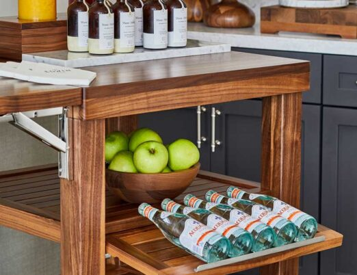 wooden display shelves with fruits, juices, and water bottles