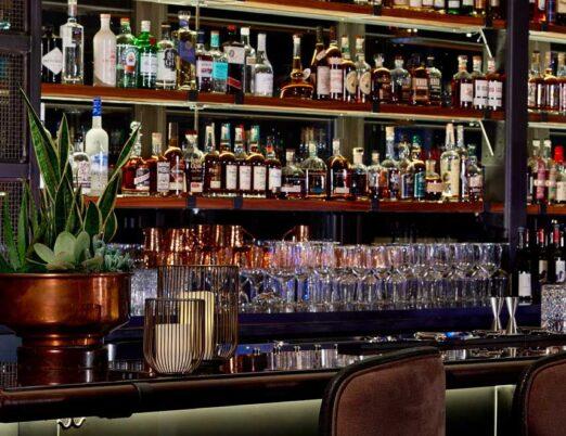 an indoor roof top bar with dozens of bottles