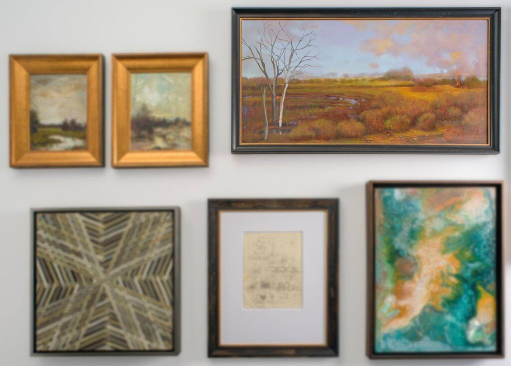 paintings by Iantha Newton displayed on a white wall