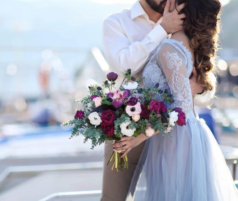 bridge and groom kissing at a marina