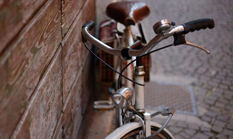 brown bike leaning on wall