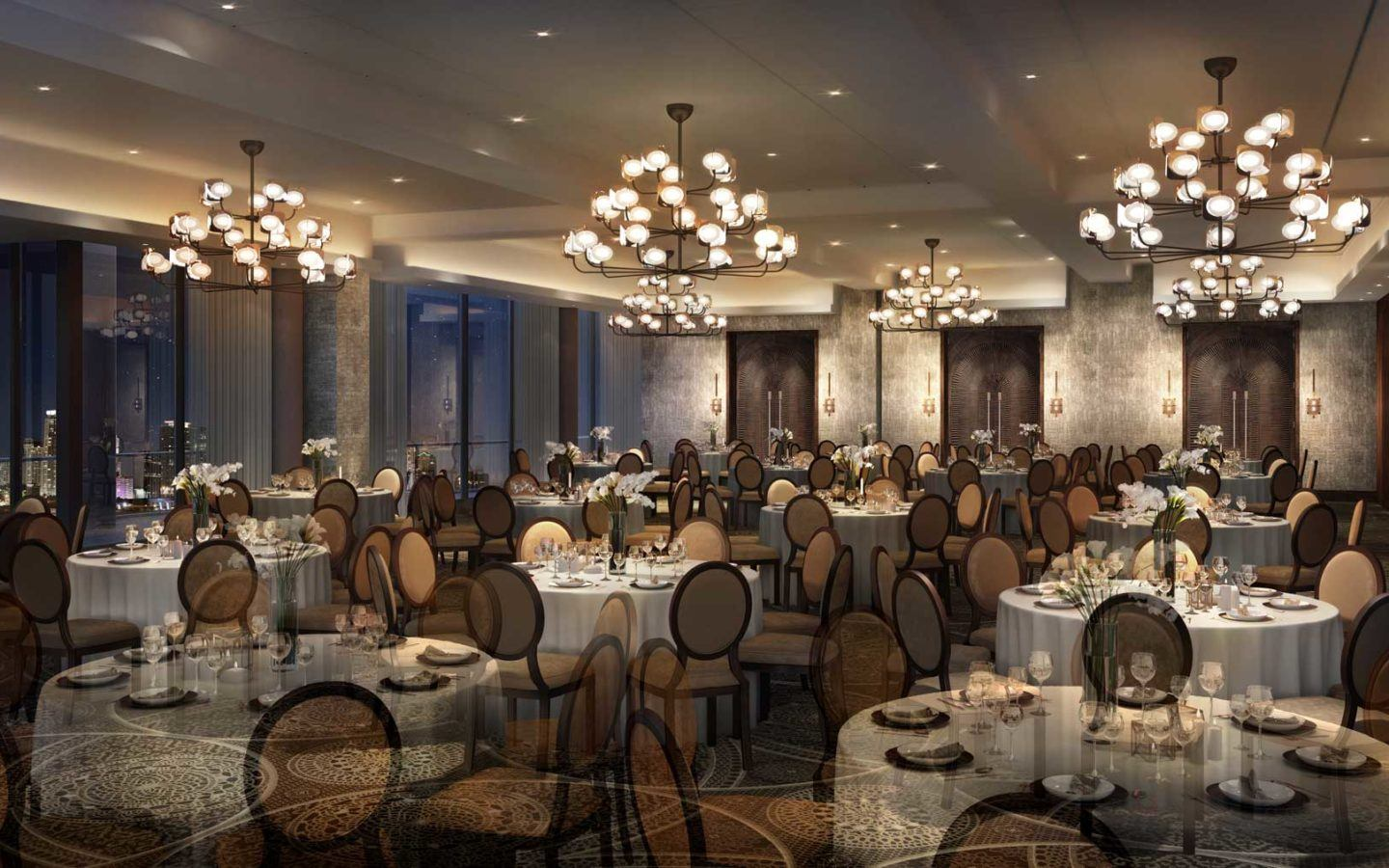 ballroom setup with white tables for event