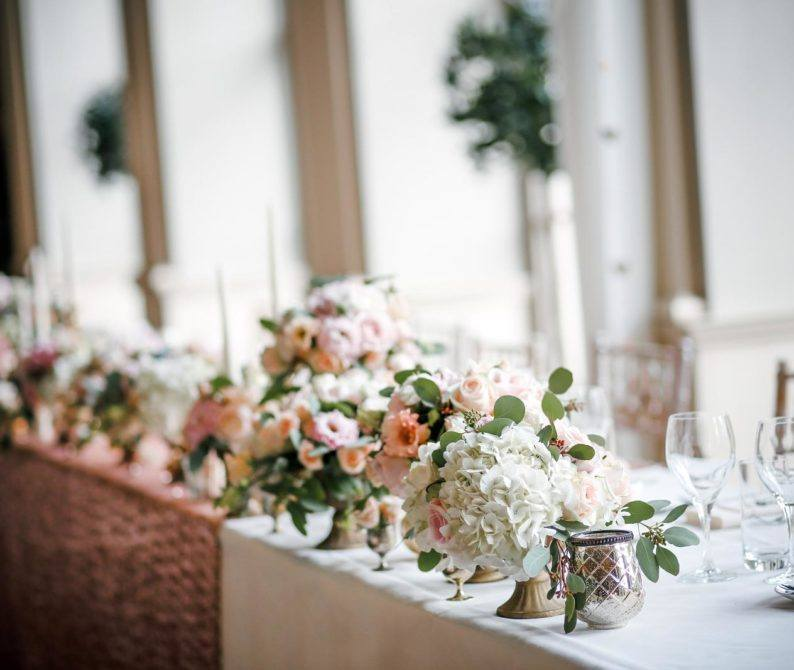 assorted flower centerpiece on tables