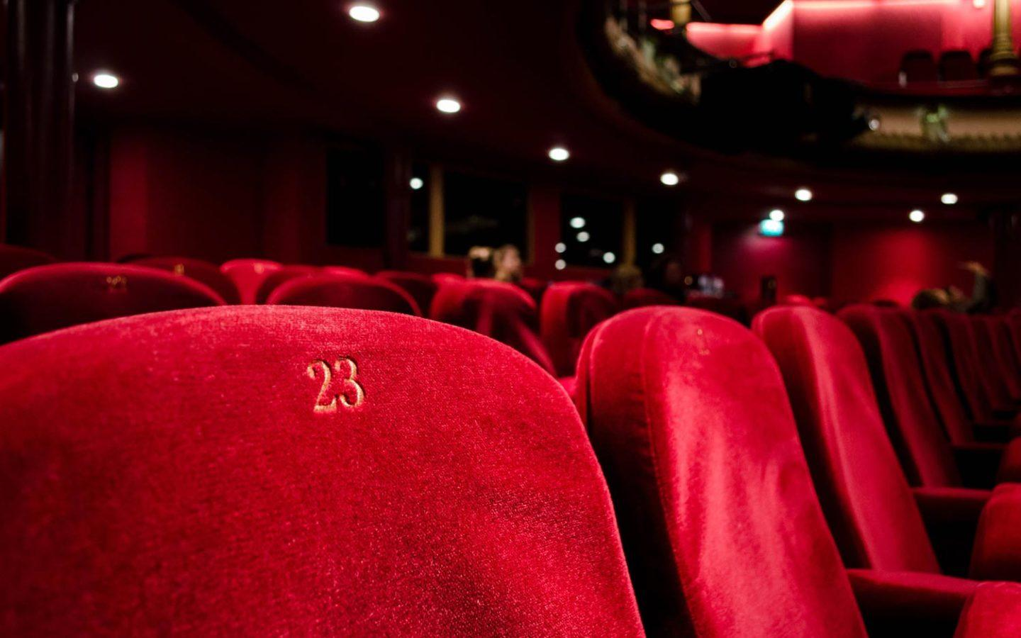 rows of performance center seats at theatre
