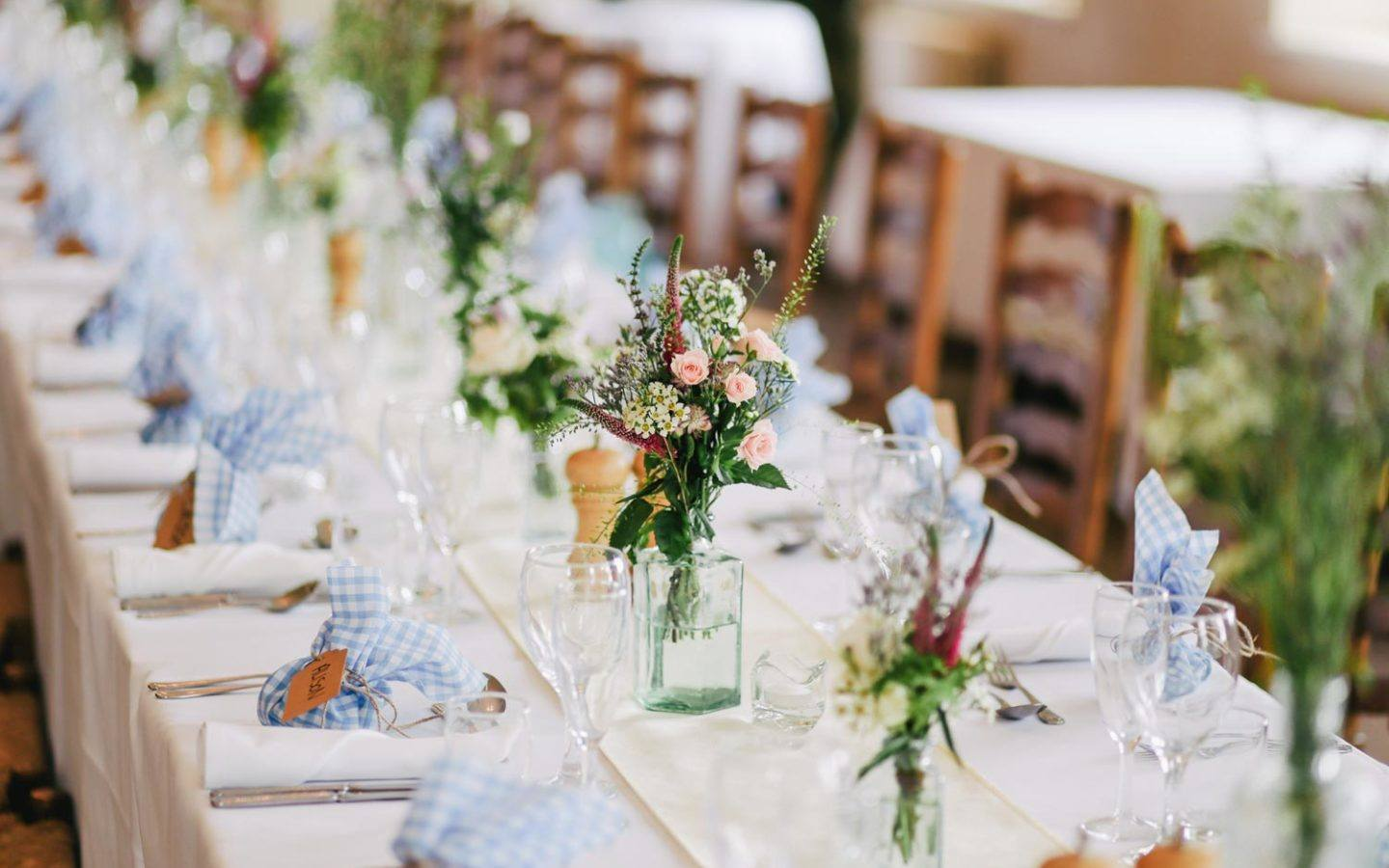 long table with tableware for wedding dinner