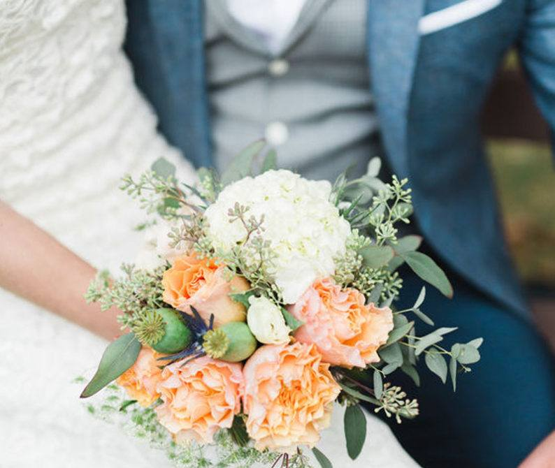 woman wearing wedding gown sitting next to groom