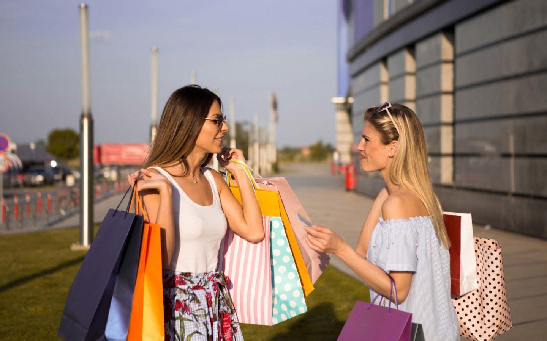 two women carrying shopping bags