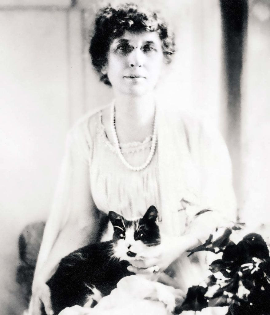 Photograph of Byrd Spilman Dewey with her cat Billie, c. 1918