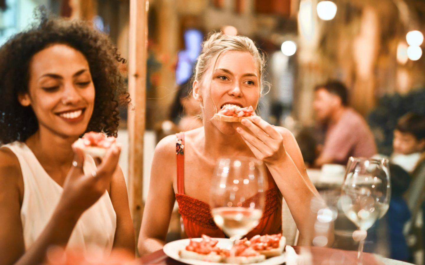 two woman eating