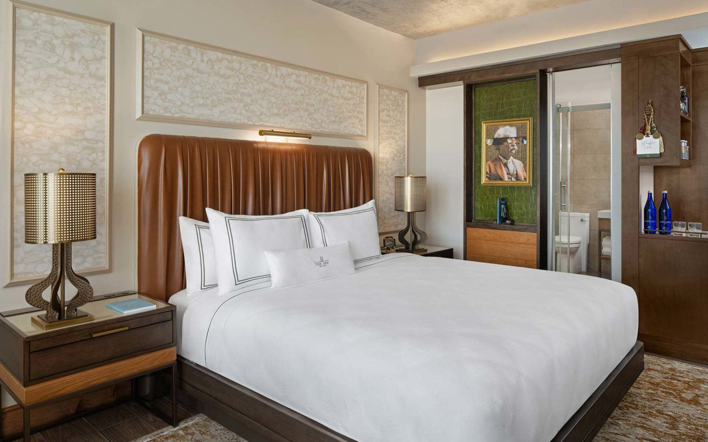 white bed linen on a king sized bed in a luxury hotel guest room