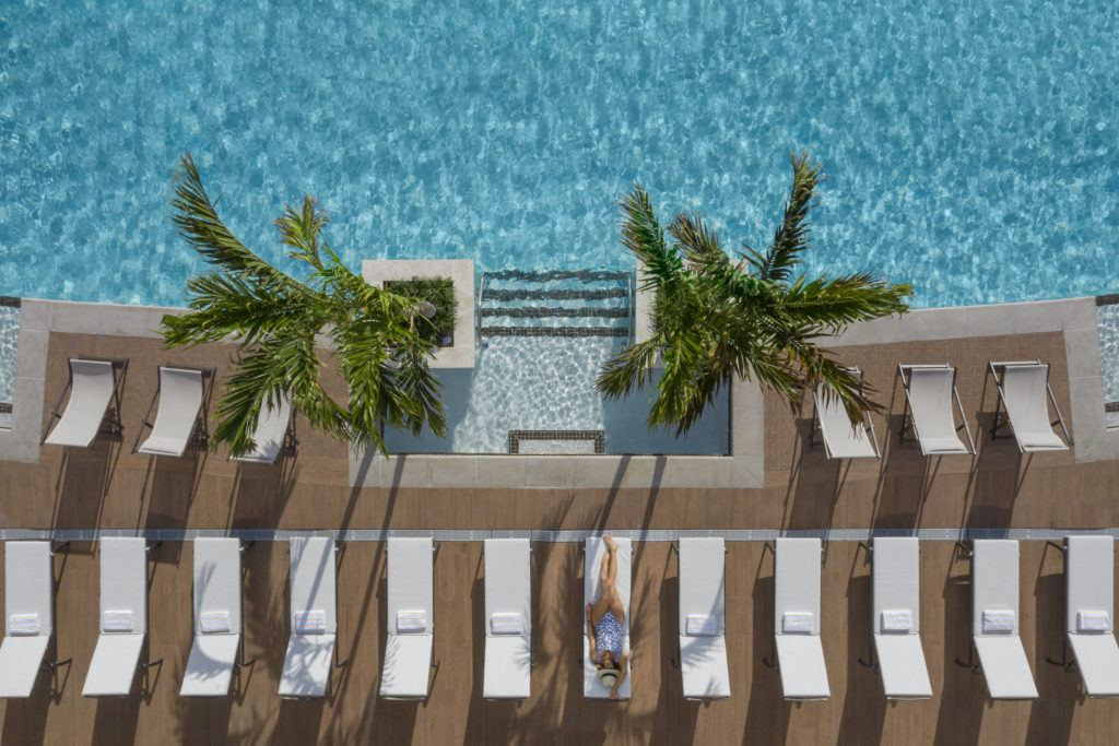 Rooftop Pool Woman on Lounger