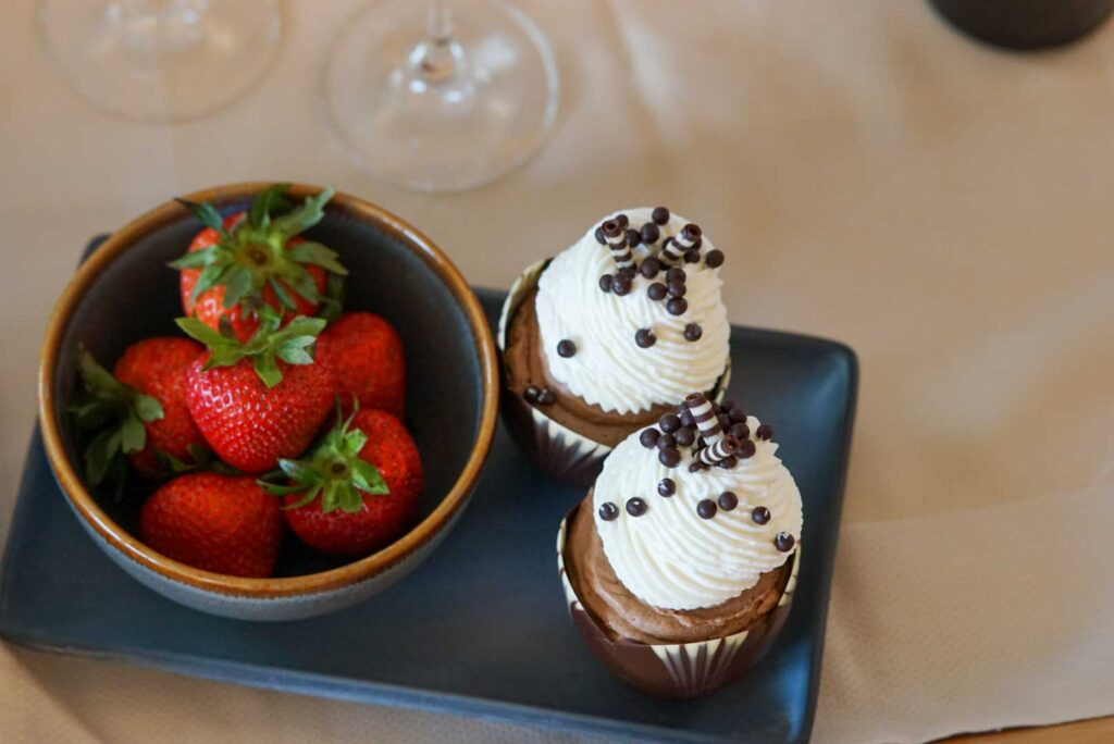 2 cupcakes with strawberries on top