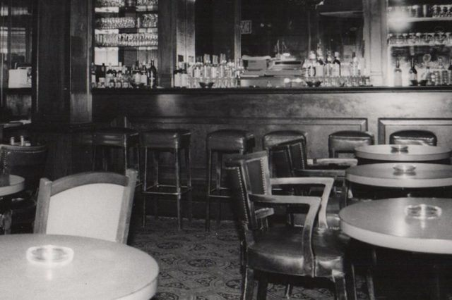 grayscale photography of dining tables in the Blue Bar in 1980