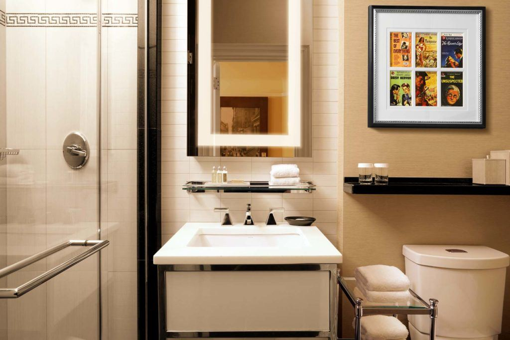 white ceramic sink and bright white towels in modern bathroom