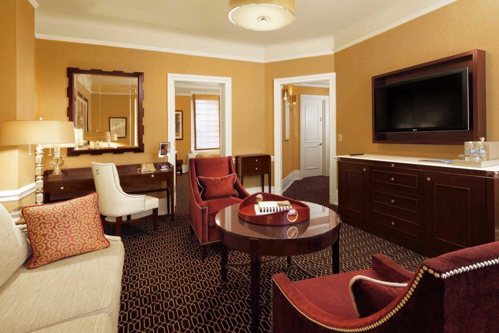 red sofa set in living area within private suite