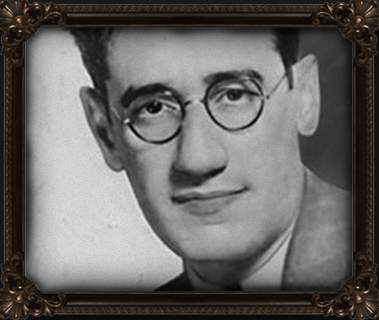 Kaufman in men's black-framed eyeglasses