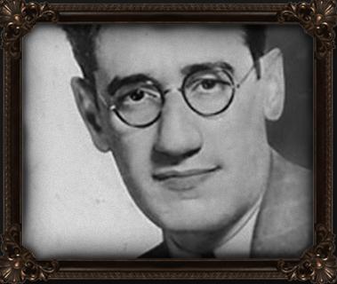 Kaufman in men's black-framed eyeglasses