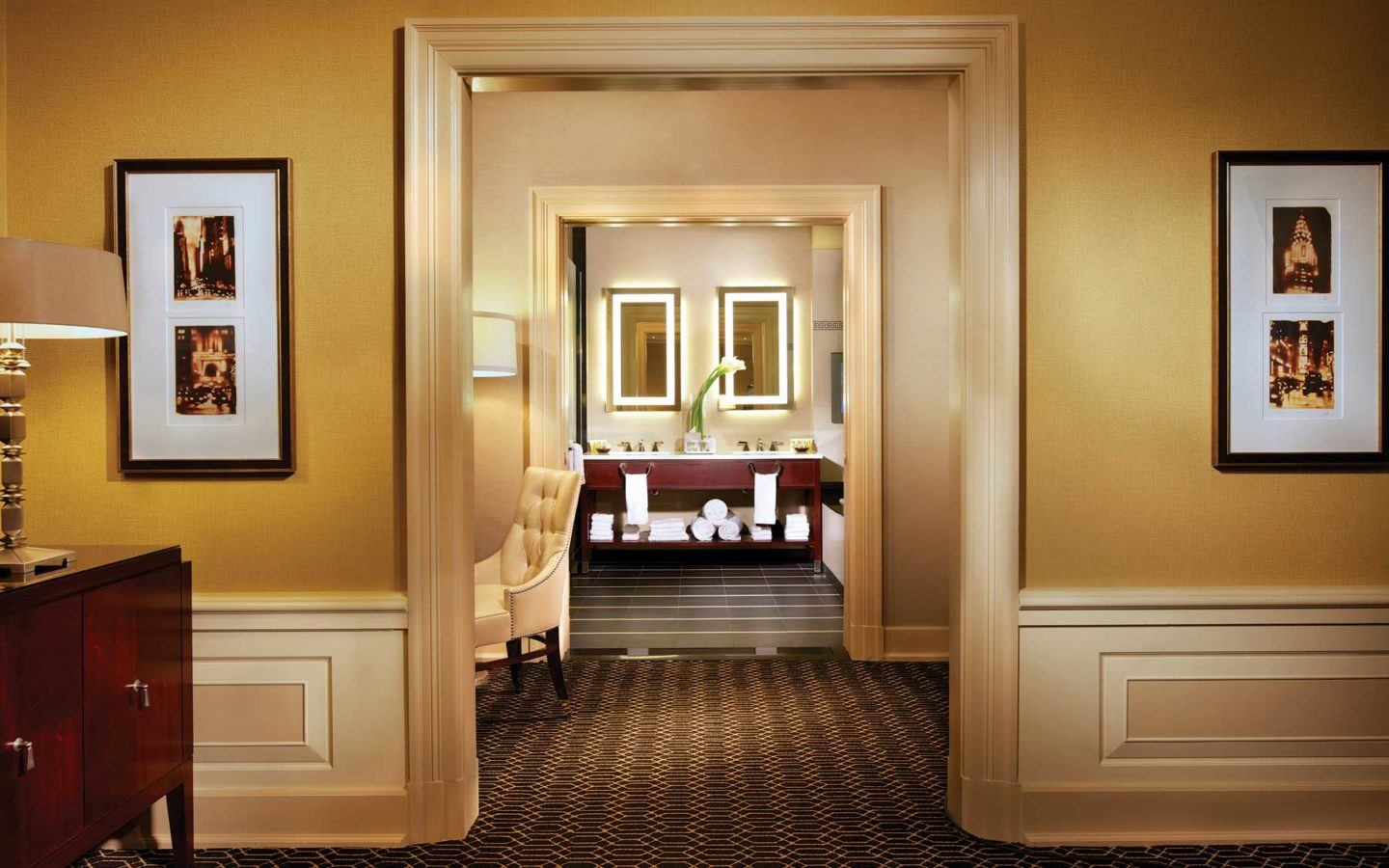 look through archways leading to the bathroom double sinks in the Barrymore Suite