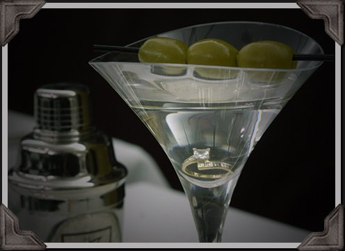 clear long-stem martini with engagement ring in the bottom
