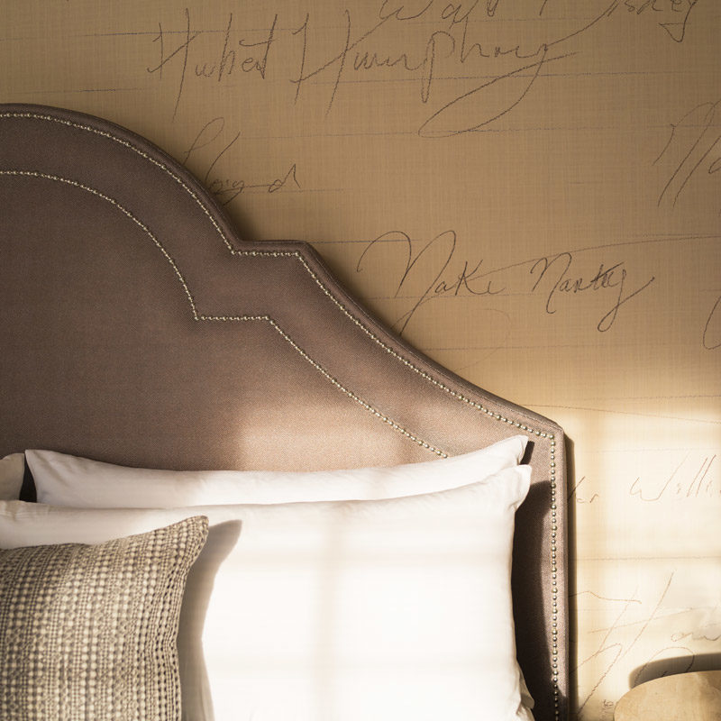 hotel bedroom wallpaper detail of signatures making pattern