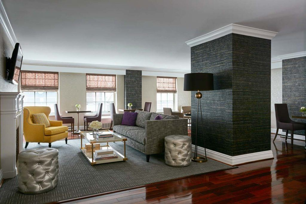 living room space with couches, decorative accents, television and dining area