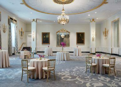 small cocktail tables as guest reception with tablecloths and flower centrepieces