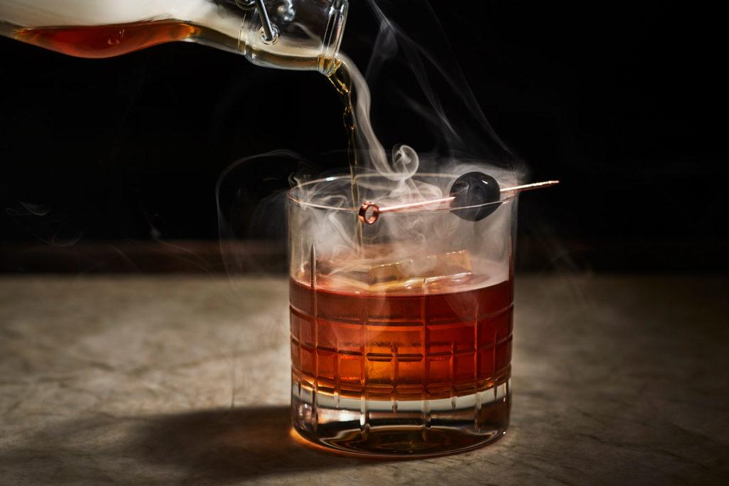 cocktail with pouring smoke as garnish