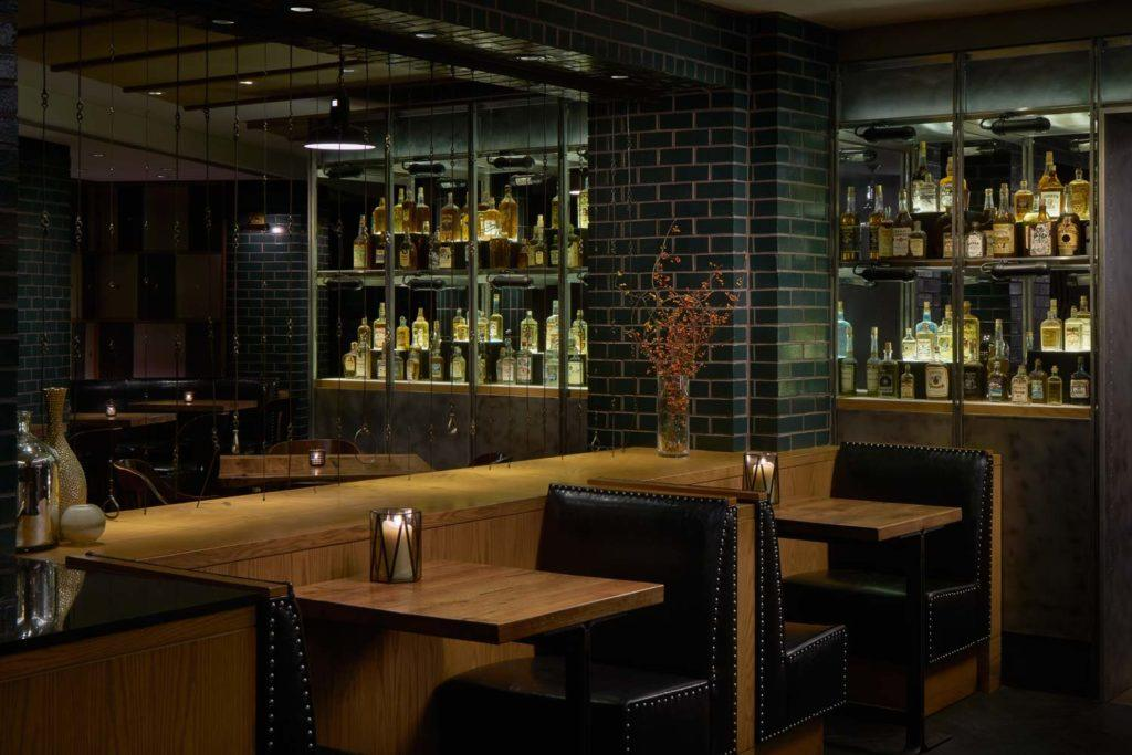 brown wooden dining table set in dimly lit restaurant