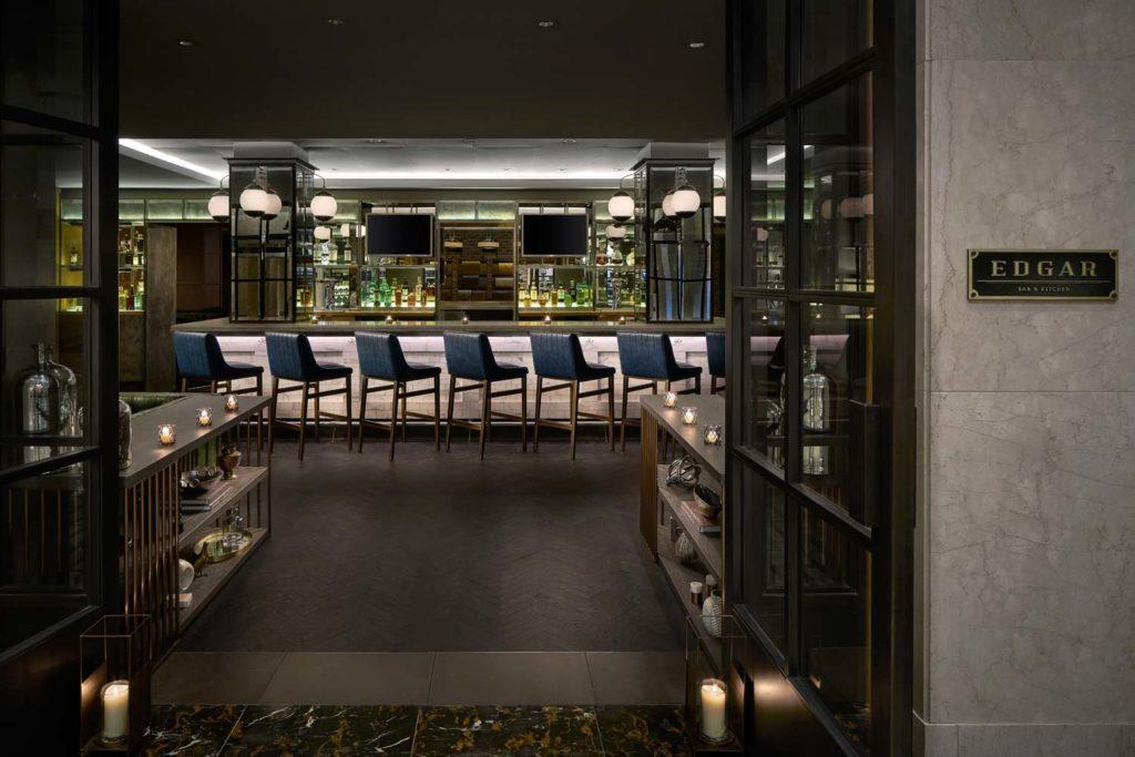 dimly lit restaurant bar seating with high rise bar stools