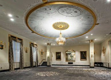white and gold uplight chandelier in empty venue space