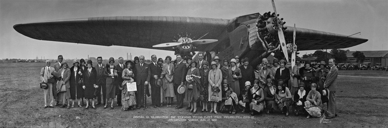 people standing near plane