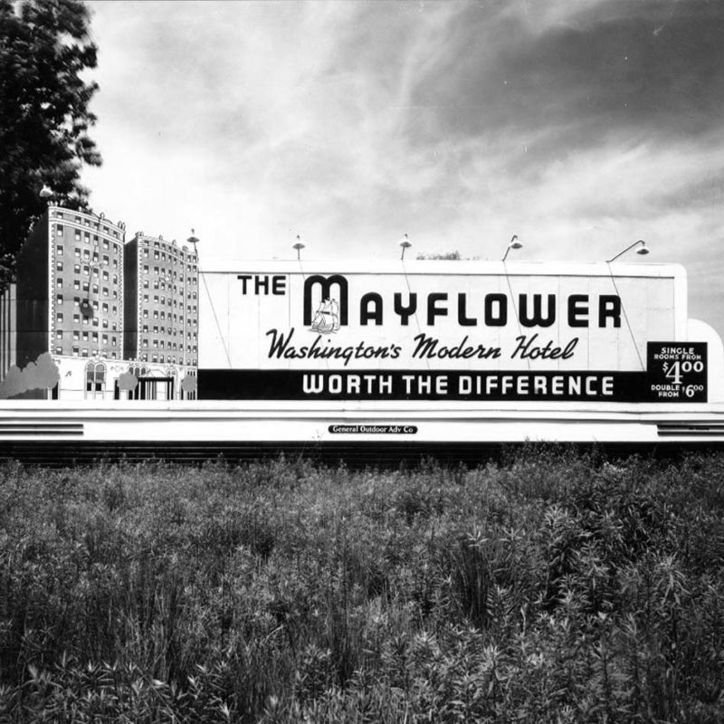 grayscale photo of 1983 hotel billboard for The Mayflower Hotel