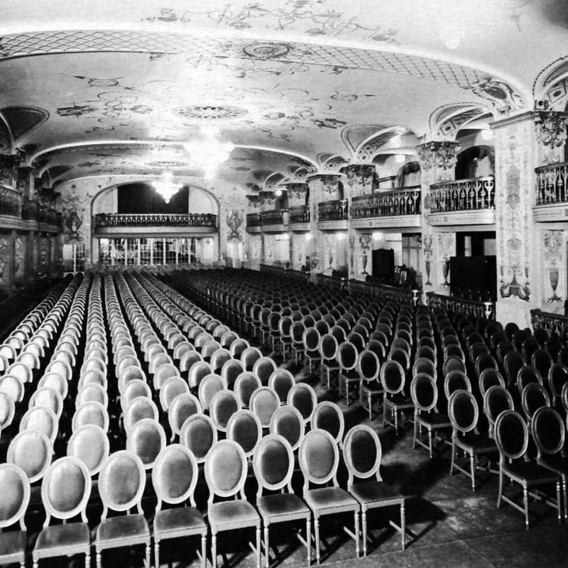 grayscale photo of theater chairs