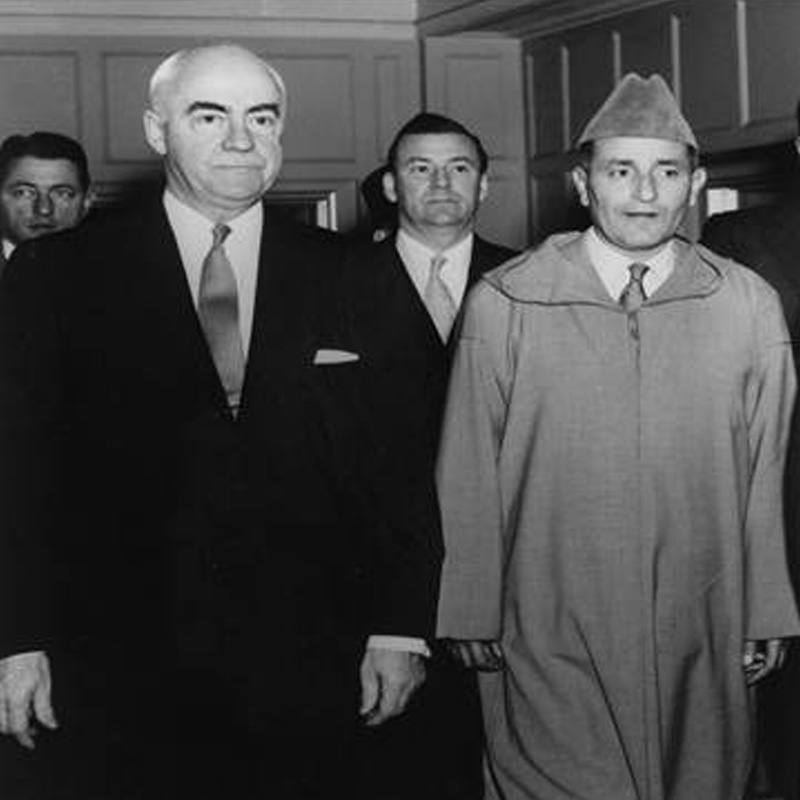 grayscale photo of 3 men in suit, one the King of Morocco in 1957
