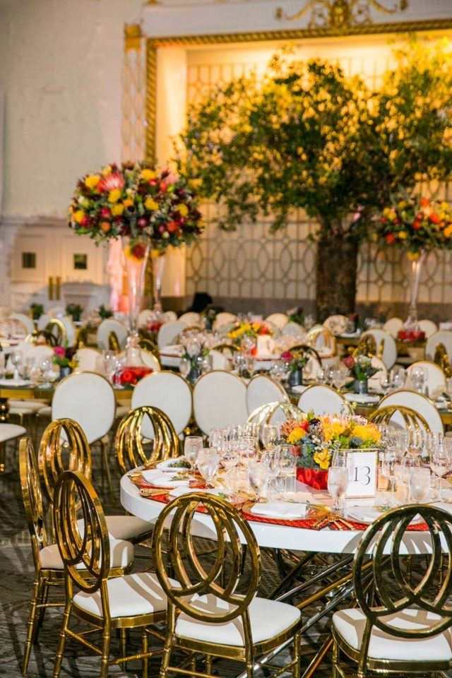 chairs at tables decorated for grand event
