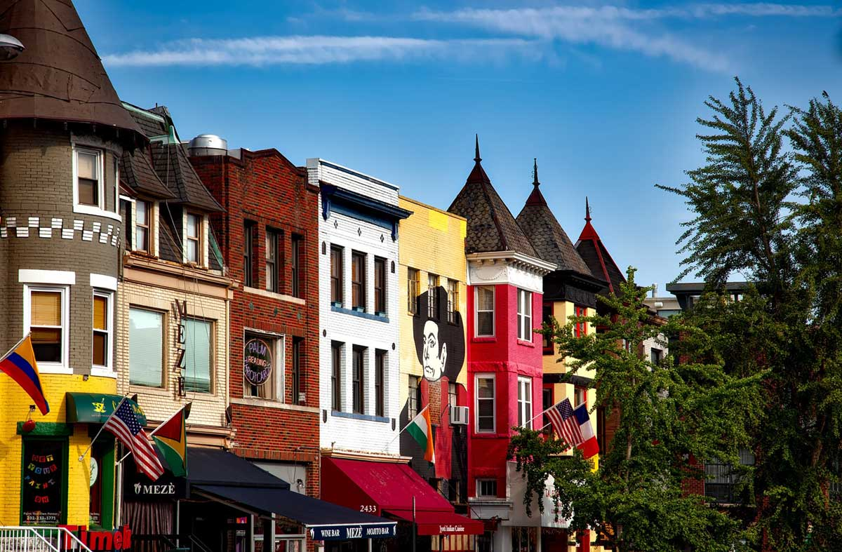 colorful store fronts line the street in Adams Morgan
