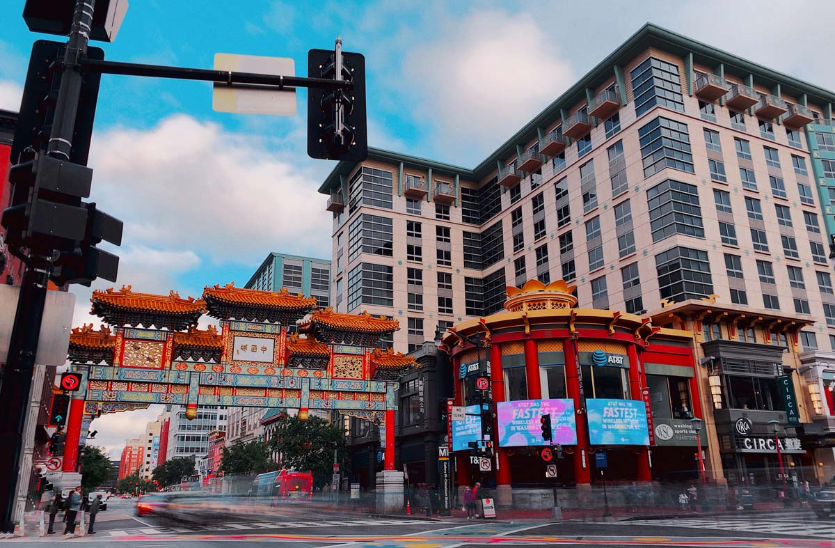 chinatown with bright red structures on busy city street