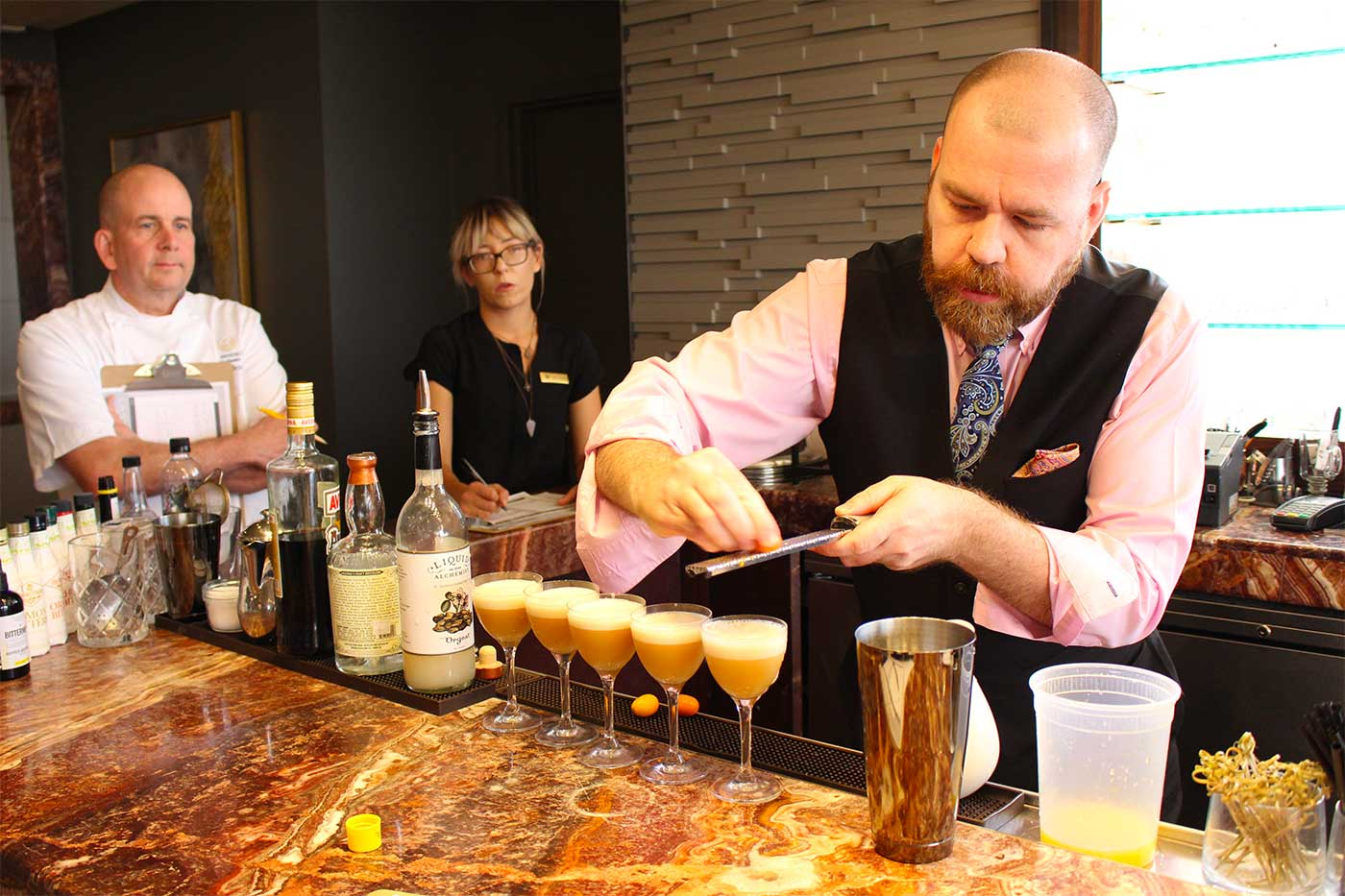 Peter Hicks prepares his cocktails