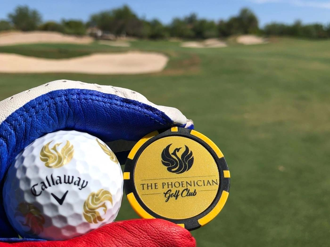 golfer holds up golf ball on The Phoenician golf course