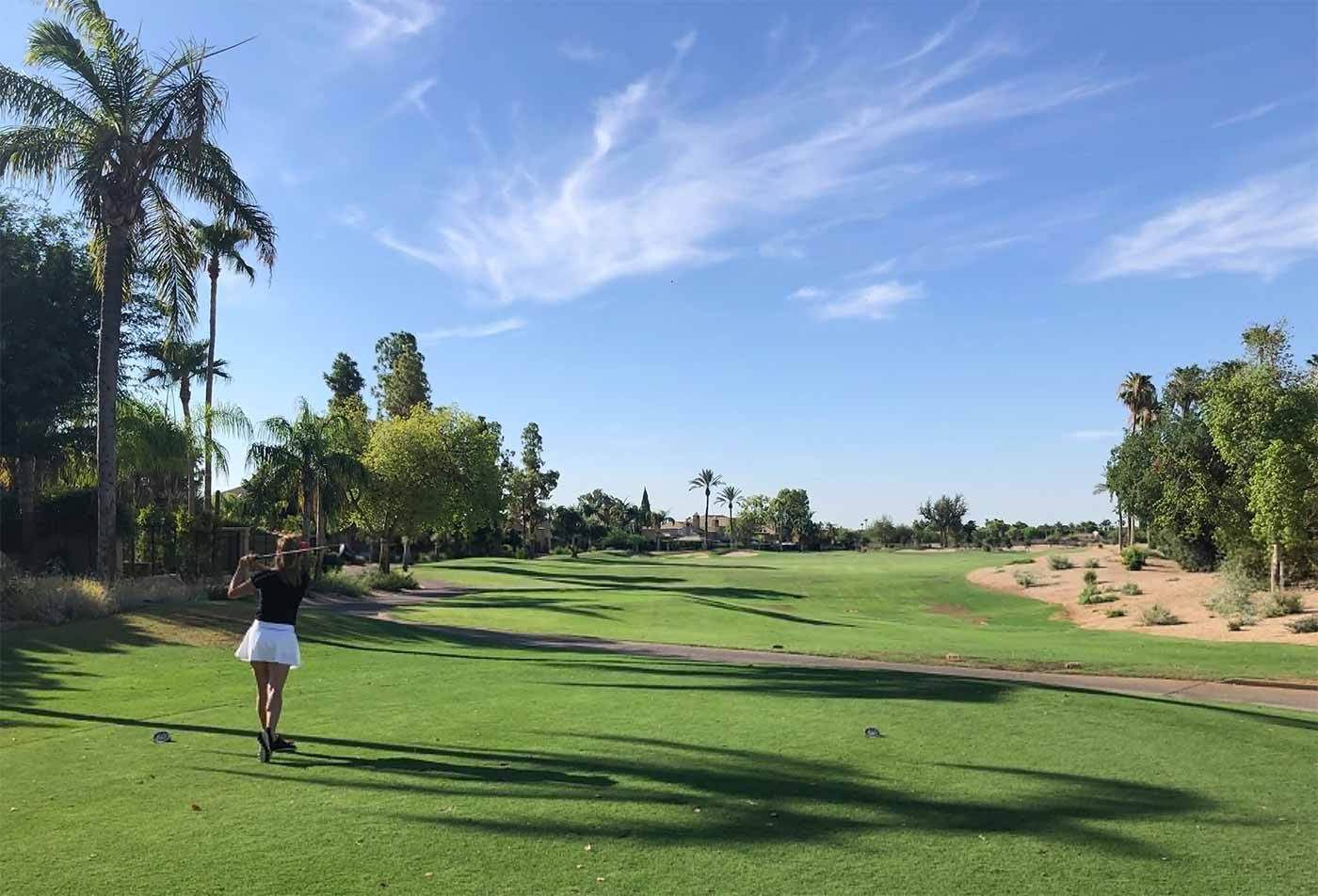 female golfer on course at The Phoenician