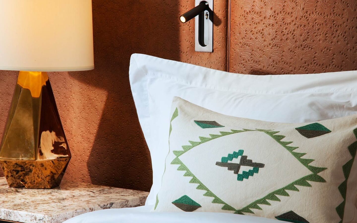 a comfortable pillow and bedside table in a luxury casita bedroom