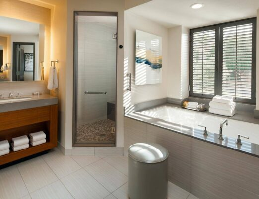 a luxury casita bathroom with shower stall and deep bathtub
