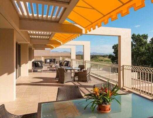 the large private terrace of the presidential suite at The Phoenician with a spectacular view of golf courses and landscape