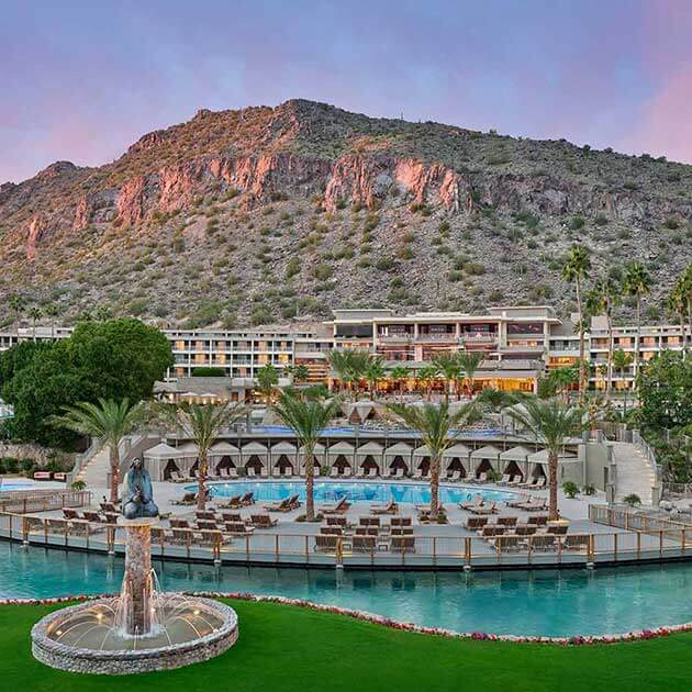 a luxury hotel resort with numerous outdoor pools at the foot of an Arizona desert mountain