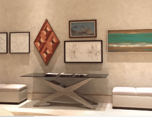 paintings hung in a group in the Canyon Suites lobby