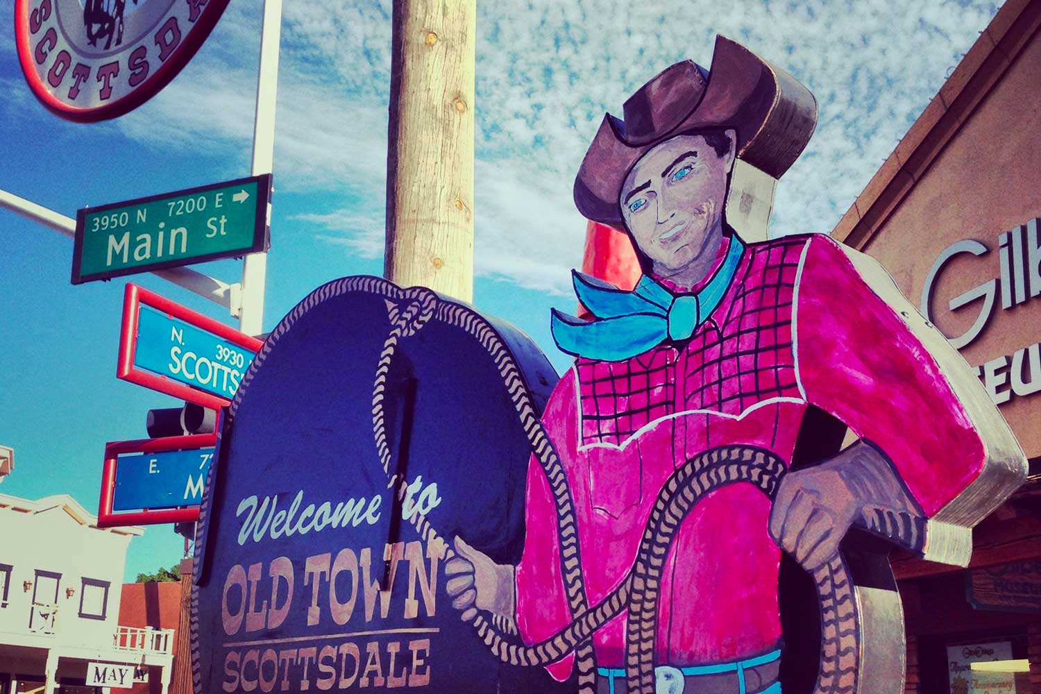 cowboy sign welcoming guests to Old Town Scottsdale